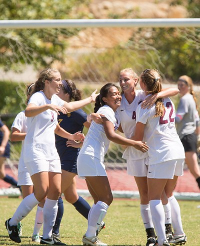Kaci Mexico, Tiffany Dimaculangan and Carly Richardson celebrate Malory Mitchell's (second from right) second goal of the game.