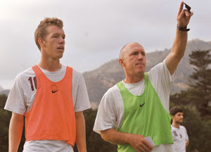 Westmont soccer player Tanner Wolf, (left) stands next to his father Dave, the team's head coach, during a training session on Thursday. GERRY FALL / NEWS-PRESS.  Reprinted with permission from the Santa Barbara News-Press.