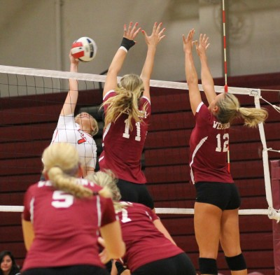 Westmont Missy Fuerst and Sydney Striff put up a block.