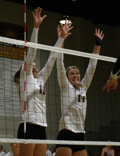 Samantha Neely (left) and Missy Fuerst put up a block.
