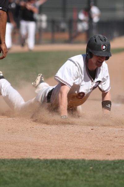 Taylor Bush scoring the winning run.(Photo by Lydia Grenko)