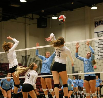 Cassidy Rea (11) and Libby Dahlberg (6) both go up on a set from Alexa Nestlerode (14)