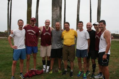 Coach Russell Smelley with alumni from the 1996 Men's Cross Country team.