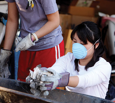 Westmont students volunteer to fill and place sandbags and assist fire victims sort through the ashes of their homes