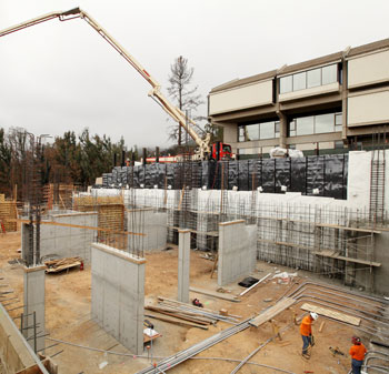 Crews construct walls for Adams Center.