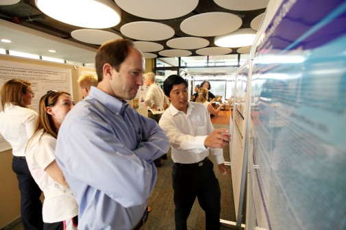 Jeffrey Kuwahara '11, a double major in chemistry and biology, explains his research to Professor Steve Julio