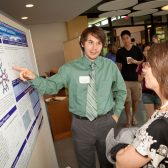 Garrett Johnson '12 explains his chemistry research at a symposium last spring