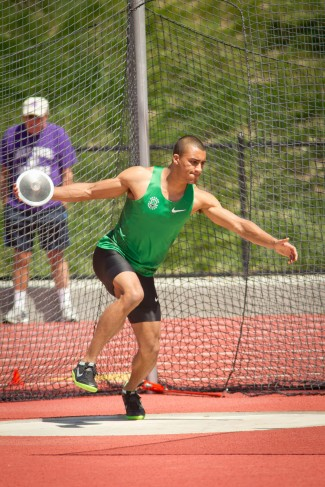 Ashton Eaton throws the discus at the Sam Adams Classic in 2012