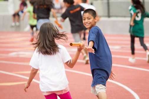 Danny Vera of McKinley Elementary School grabs the baton in an 8X50 co-ed race