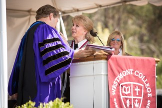 President Gayle Beebe gives the Westmont Medal to Annette Simmons with Amy Simmons nearby