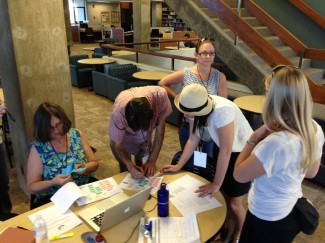 Debra Quast (left), library director, gives Team Northridge another clue after it successfully completed a roadblock