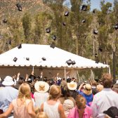 The class of 2014 tosses its mortarboards to the sky
