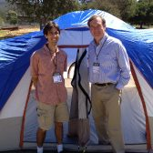 Neil Di Maggio, director of research, and Provost Mark Sargent proudly display their tent