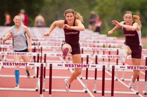 Collier competes in the 100-meter hurdles