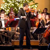 Violinist Han Soo Kim performs during the Christmas Festival