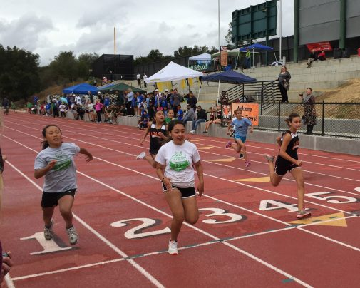 Brenda Castro of Washington wins her heat in the girls 80-meter race