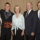 Evan Kramer with coach Russell Smelley, the Jordano's and President Beebe