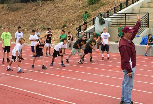 Coach Russell Smelley starts the boys 80 meter race