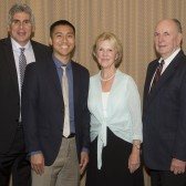 Stefan Inouye with coaches John Moore and Jeff Azain, the Jordano's and President Beebe