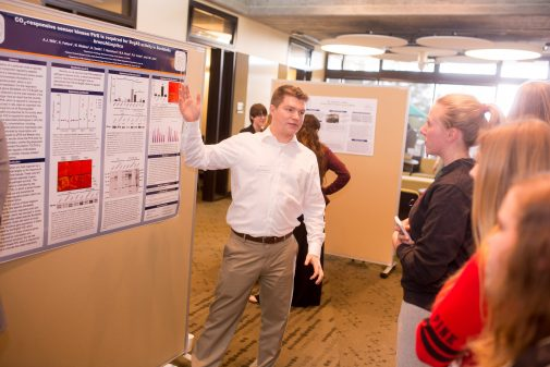 Kirk Fetters, a triple major in biology, chemistry and kinesiology, explains his research in 2015