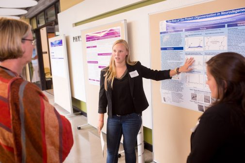 Megan Korff, a double major in chemistry and biology, presents her research in 2015