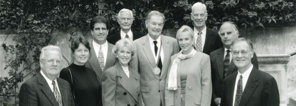 Larry Crandell with the Westmont Medal at Commencement 2005 with Foundation members Gary Harris, Marguerite Berti, Tim Tremblay, Gerd Jordano, Stewart Abercrombie, Sharon Clenet, David Yager, Pier Gherini, President David K. Winter