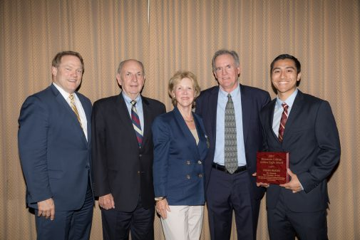 John Moore poses with Stefan Inouye. Also pictured: President Gayle D. Beebe, Pete and Gerd Jordano