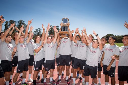 The Warriors pose with the Bryant & Sons Cup at Thorrington Field on Aug. 21.