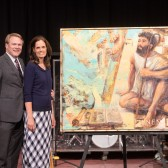 Gayle and Pam Beebe pose with the painting after chapel