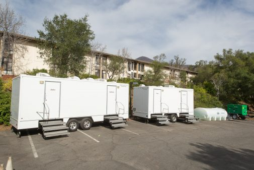 Portable showers and restrooms have been brought onto campus due to lack of drinkable water