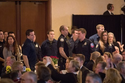 First responders stood before receiving a standing ovation