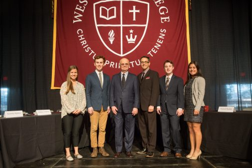 Students and Professor Don Patterson pose with Gen. Hayden at convocation on campus