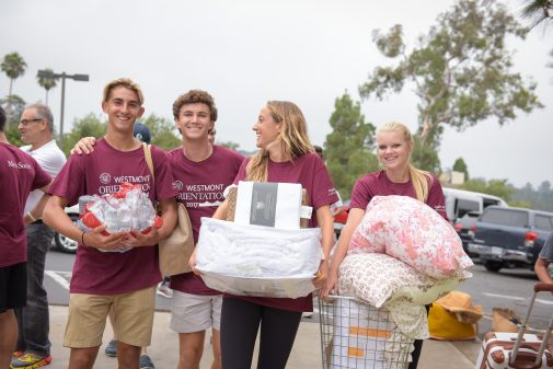 Student volunteers unload cars and move new students into their residence halls