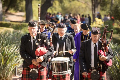 Led by bagpipers, the incoming class makes its First Walk through the Formal Garden