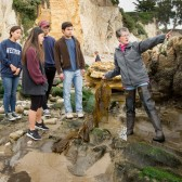 Beth Horvath with students in tide pools near Ledbetter Beach