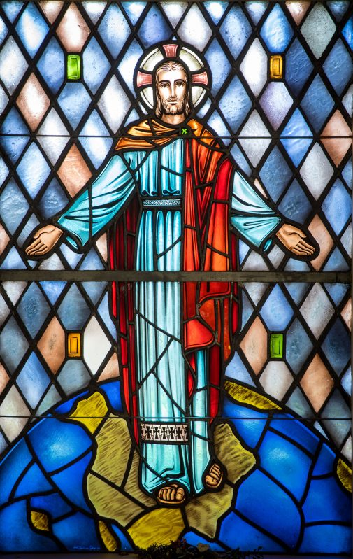 A stained glass image of Christ inside the Voskuyl Prayer Chapel