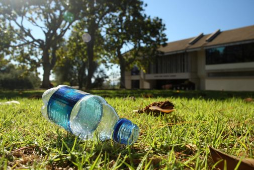 a used plastic water bottle sits on Magnolia Lawn at Westmont, environmental studies