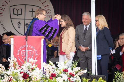 President Beebe offers the Westmont Medal to Katherine Wiebe and Lindsay and Laurie Parton