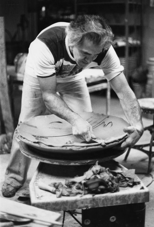 Reitz throwing a large platter, c. 1980