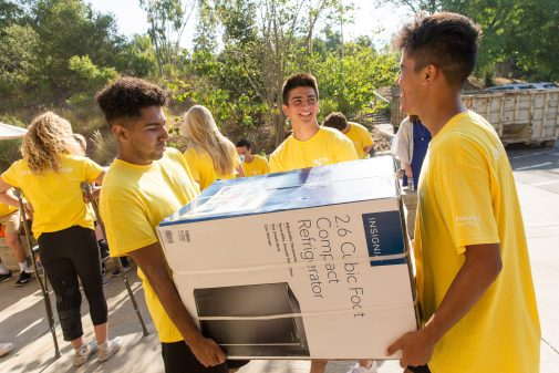 Westmont athletes help new students move into their residence halls.
