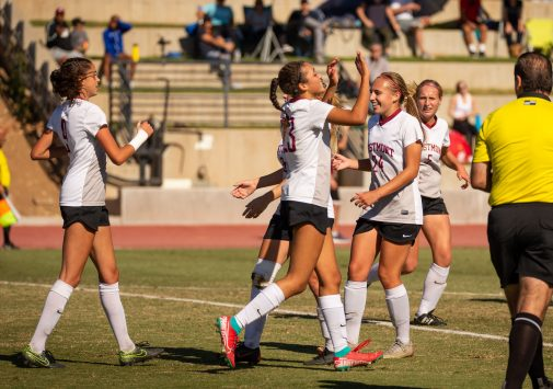 Sophomore forward Katie Stella (left #9) is congratulated after scoring the winning goal Nov. 23
