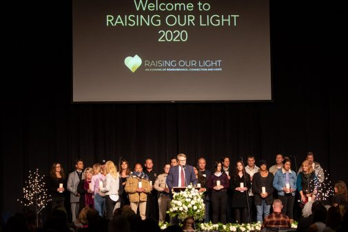 Westmont President Gayle D. Beebe stands with candle holders who helped the community heal during the past two years