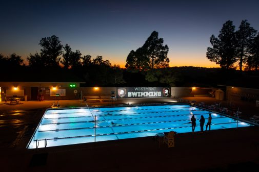Westmont swimmers practice at sunset