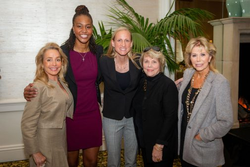Andria Kahmann, Penny Jenkins and Anna Grotenhuis, the Women's Leadership Council co-chairs, pose with Tamika Catchings and director Kirsten Moore.