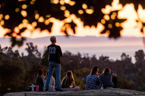 Students gather on the Westmont Rock for views of the sunset and Santa Cruz Island