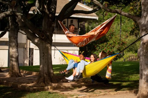 Westmont students enjoy hanging in hammocks on the Magnolia lawn in front of Voskuyl Library