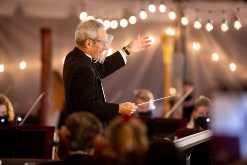 Dr. Michael Shasberger conducts outdoors