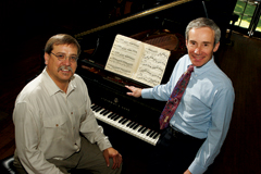 Steve Hodson and Michael Shasberger with a Steinway piano