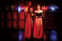 """In the stage version of """"Jane Eyre,"""" the wild woman Bertha Mason (Marie Ponce '10) always lurks in the background behind Jane Eyre (Sarah Halford '09)"""