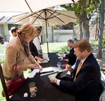 """President Gayle Beebe and Richard Foster signed copies of their book, """"Longing for God,"""" on campus in April."""